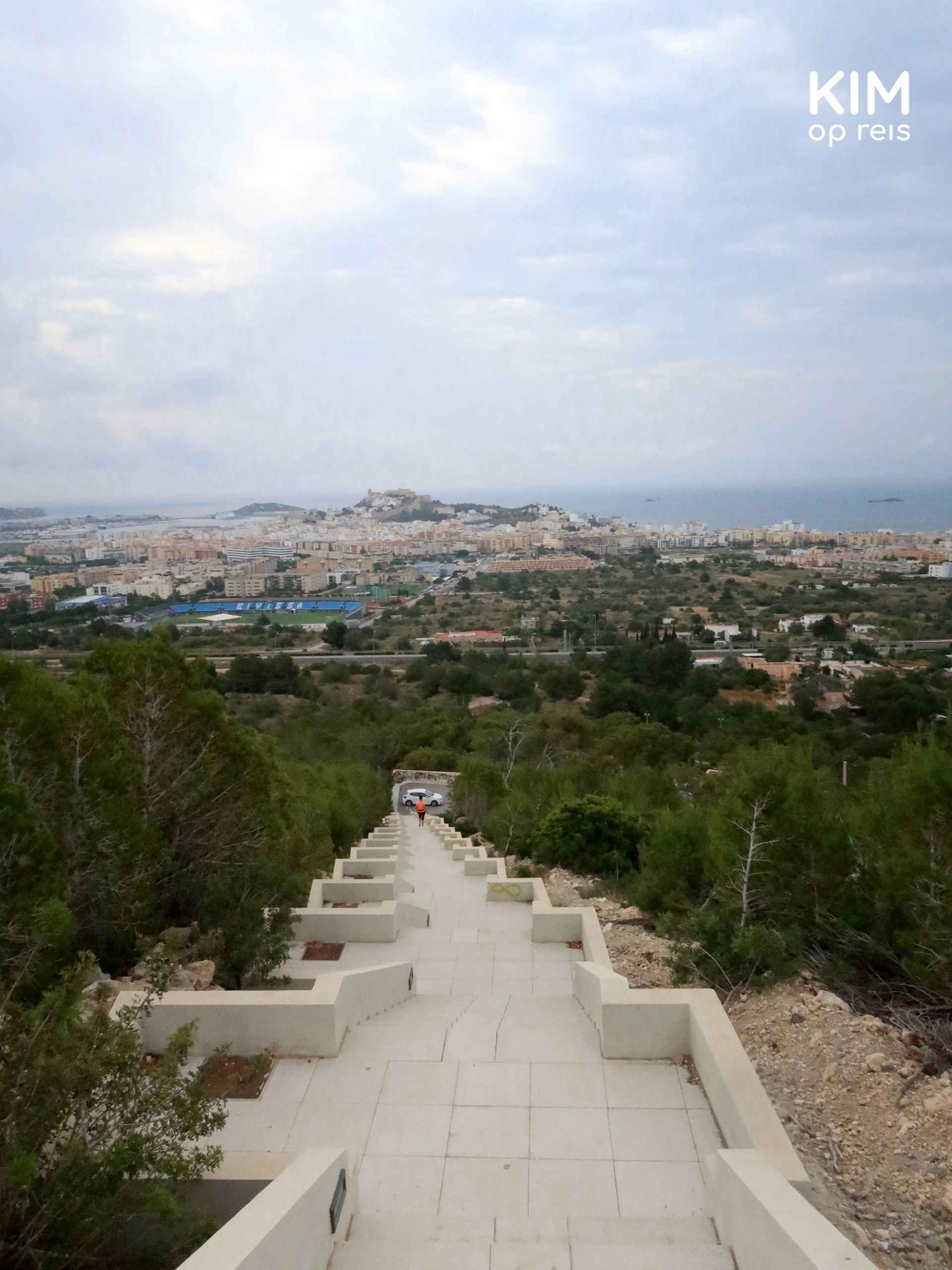 Stairs viewpoint Ibiza Town: from the top of the stairs, you look over the stairs and the town in the distance