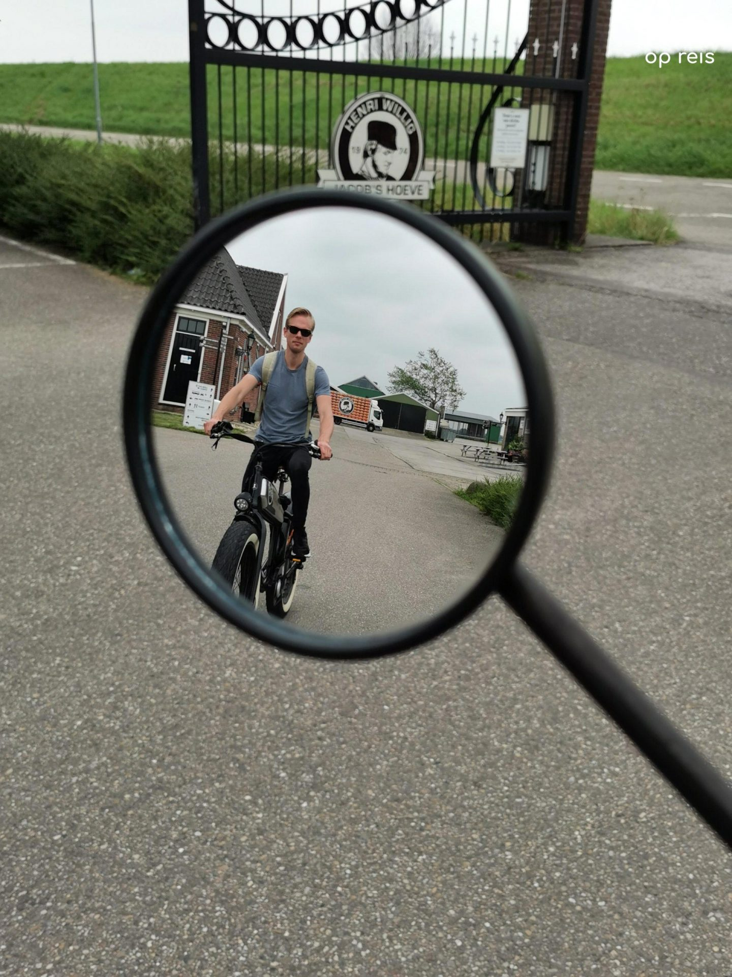 Cruising on the fat bike - Patrick is riding a fat bike in the rear-view mirror of the e-scooter
