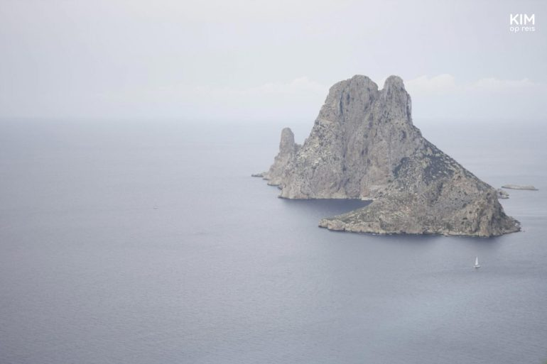 Es Vedra, at Cala Llentrisca - the rock Es Vedra in the sea on a misty, gray day