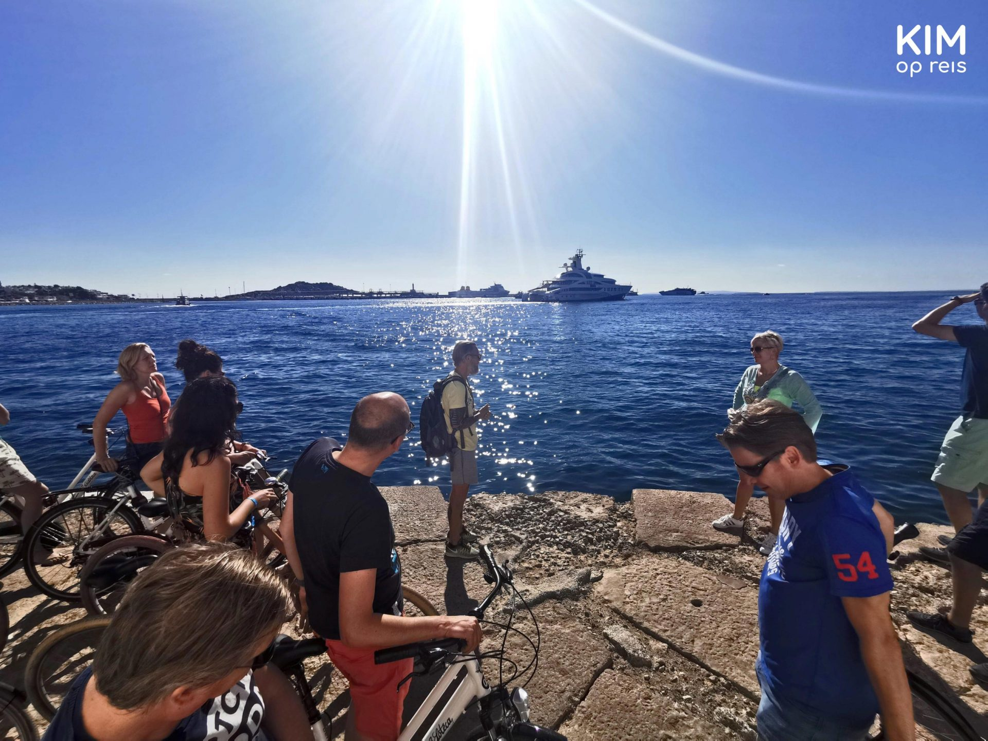Ibiza excursion tour cycling - group of participants listens to the guide in the sun