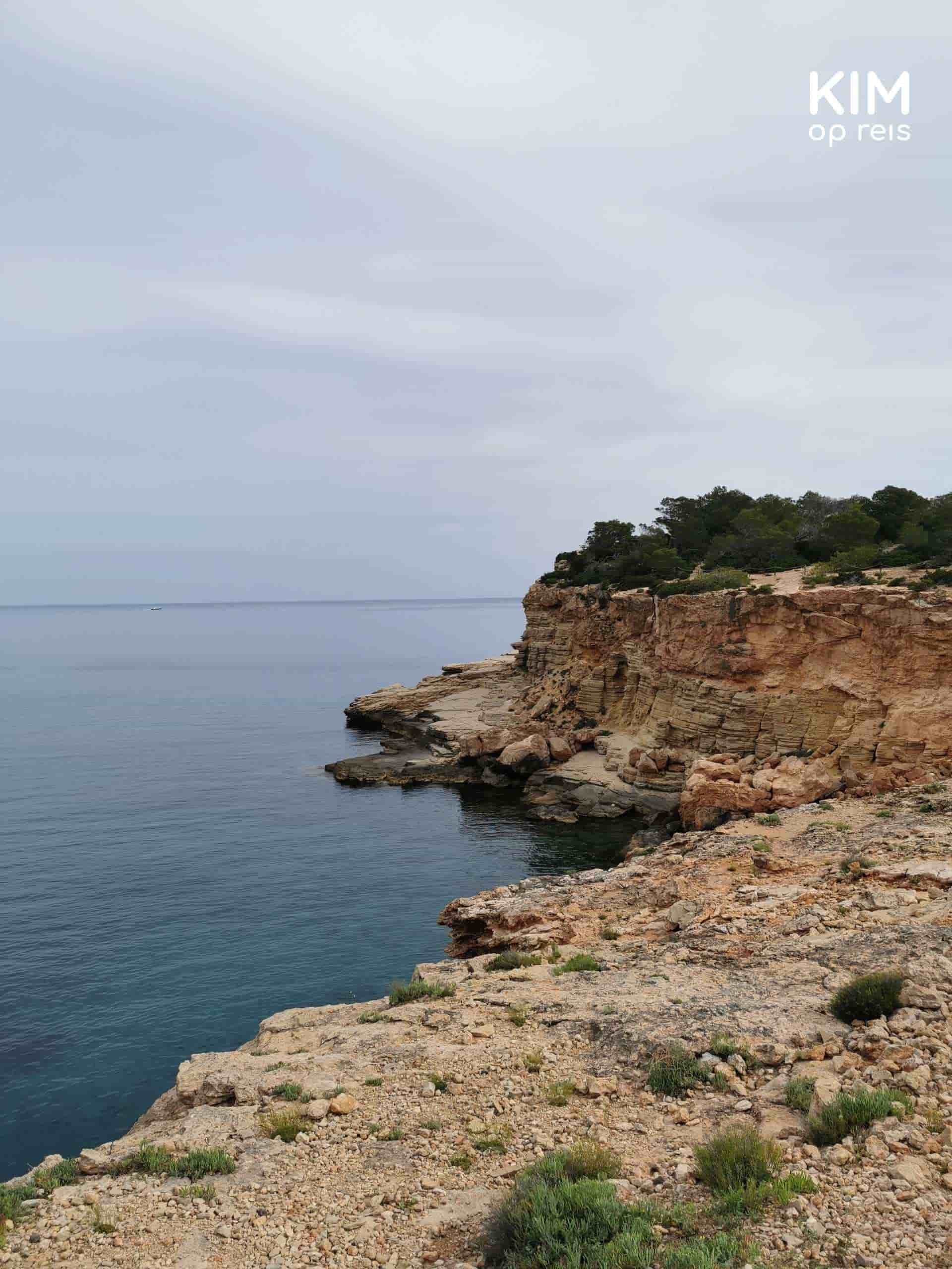 Punta Galera yoga Ibiza: view over the bay and the rocks on a cloudy day