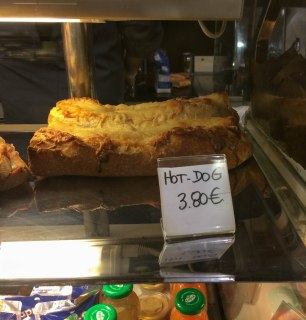 Hot Dogs in France are baguettes with TWO hot dogs inside. This one is a little fancier with cheese and what not...