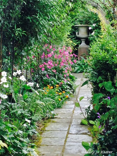 An urn is the focal point along this secondary pathway.