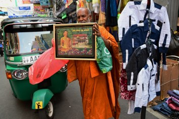 Monk on the street - Photography by Kimy Chang