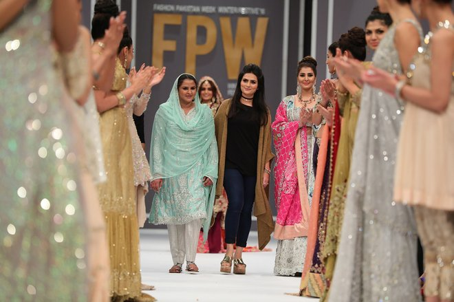 Showstopper Mukhtar Mai walking with designer Rozina Munib.