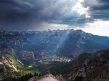 """Sunlight beams through stormy clouds, as seen from the top of the Amphitheater far above the town of <a href=""""search.php?q=ouray"""">Ouray</a>, Colorado. A strange thing... as I was standing here 5,000 feet above town, I could hear a band playing way down there!"""