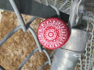 Kindness rock on fence