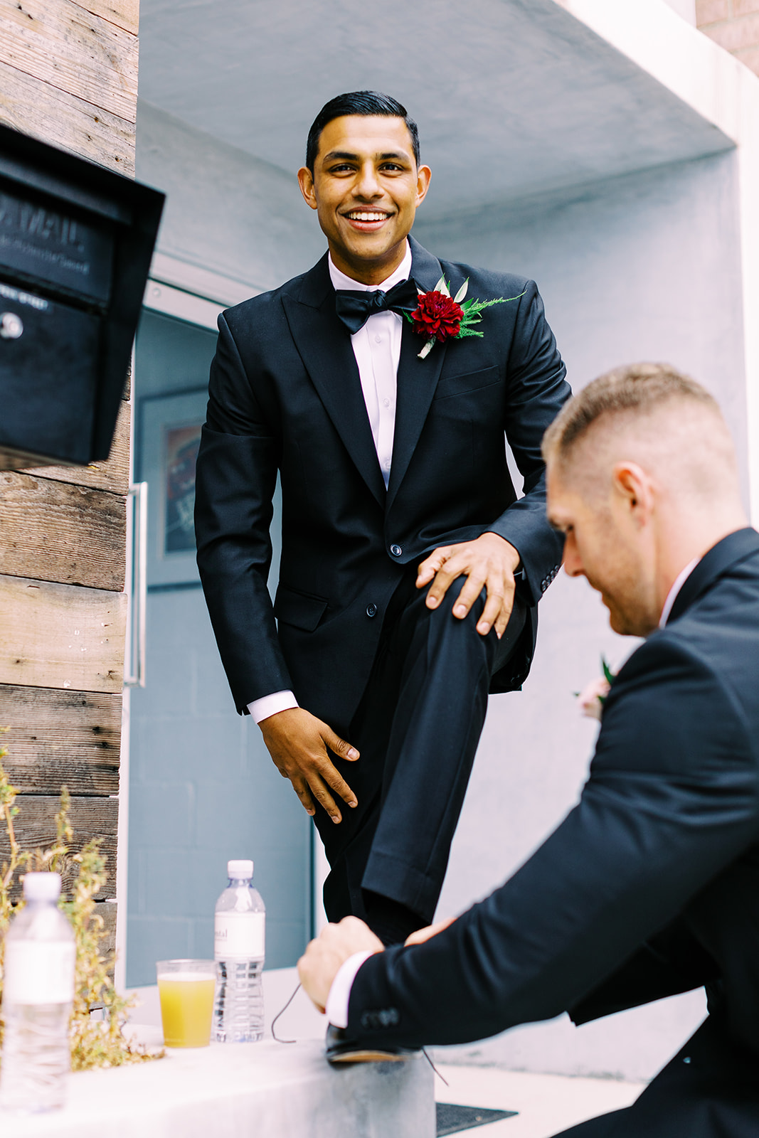 Groom gets shoes tied