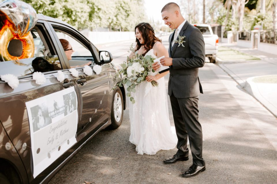 Bride and Groom Greet drive by parade wedding guests