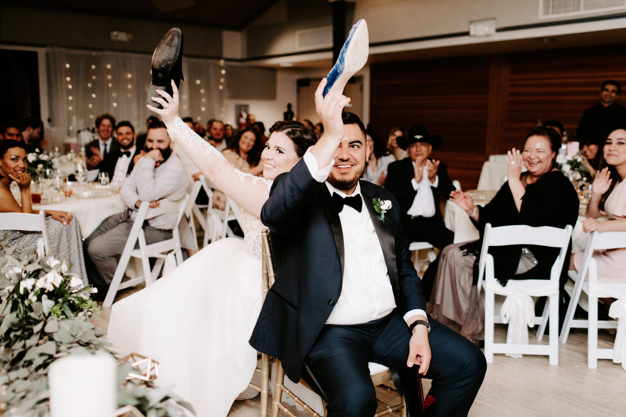 Bride and Groom playing the shoe game