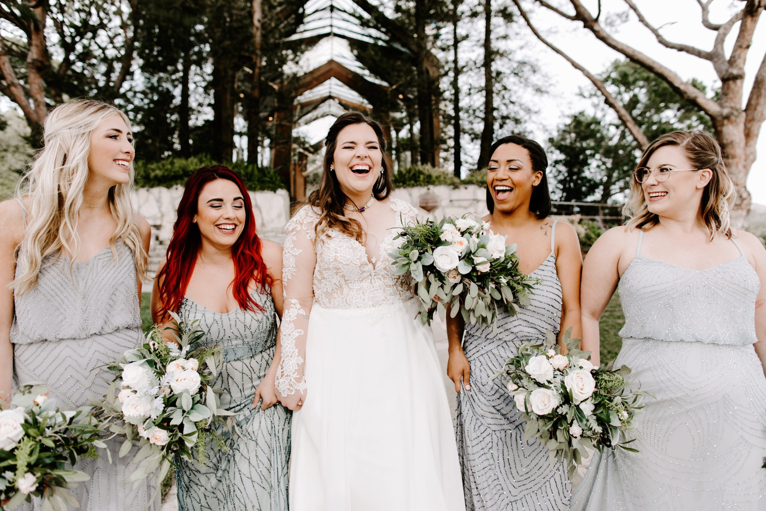 Laughing bride with bridesmaids at Wayfarers Chapel