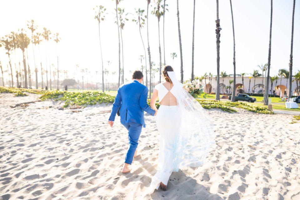 Couple on beach after wedding ceremony in Santa Barbara