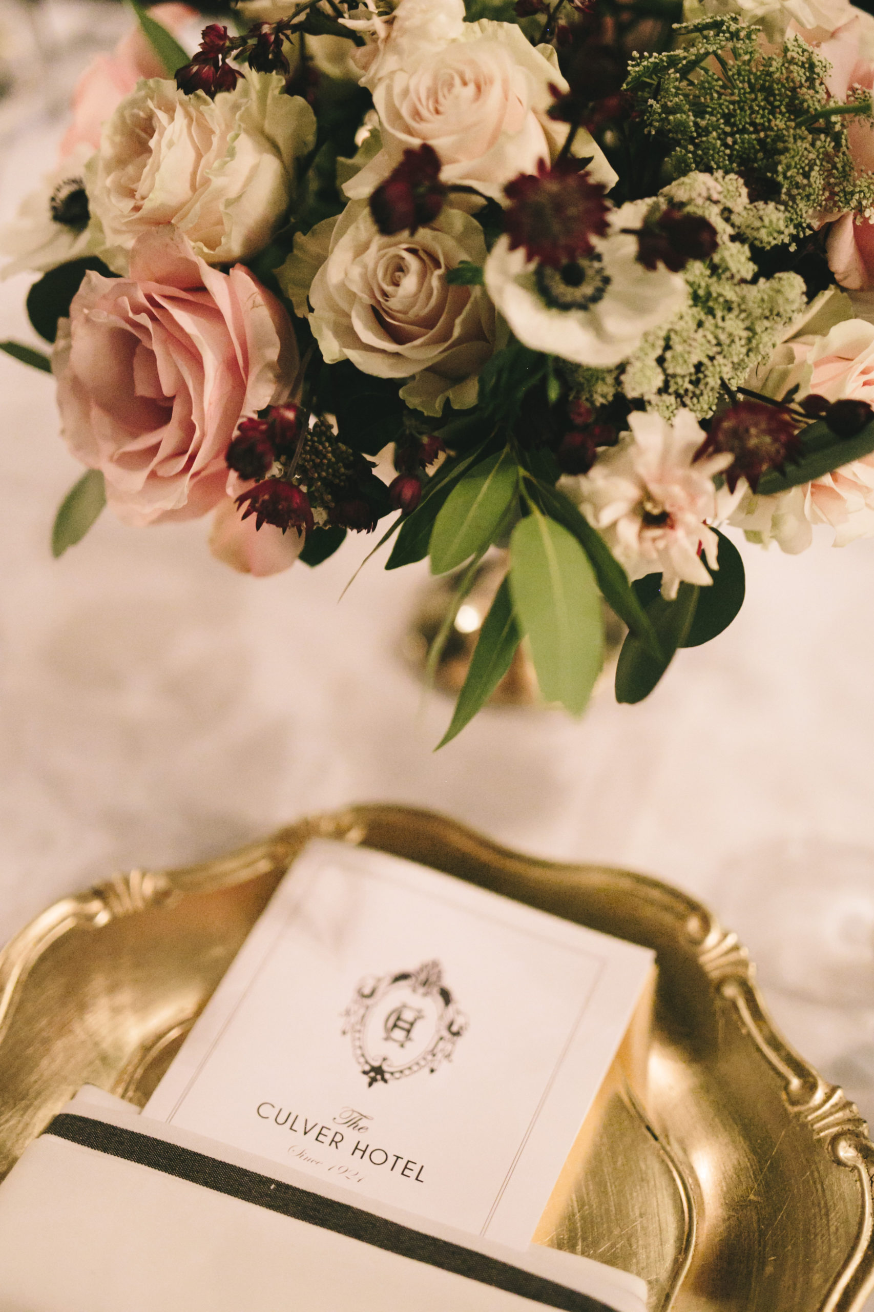 Gold charger table setting at wedding