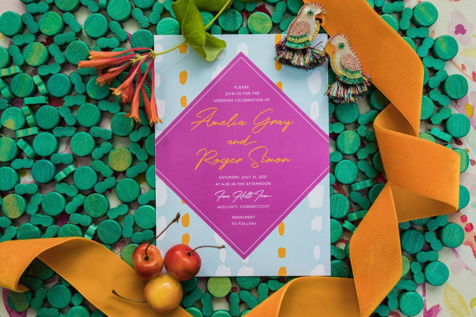 Spanish inspired wedding stationery filled with bright oranges, greens, and pinks