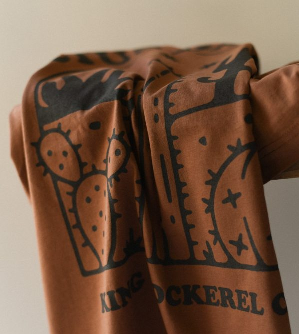 Close up of Back of brown King cockerel T-shirt