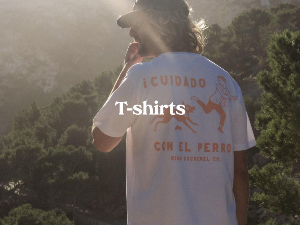 Man in white King Cockerel T-shirt