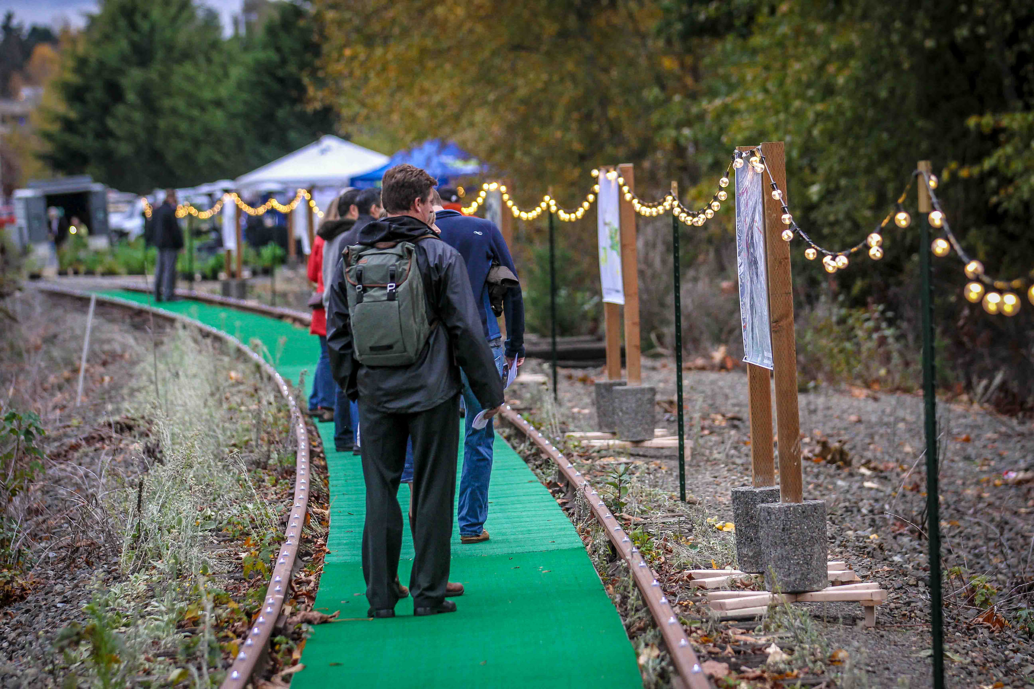 Enlivening Wilburton: Trailside Cafe, was a pop-up outdoor cafe where rails become a trail and for one evening a rail corridor was transformed into a lively community gathering place, setting the vision for this as a future location of an iconic community space.