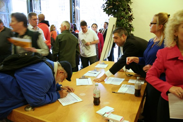 People sign up to speak at a state transportation hearing in Seattle Oct. 14, 2013.