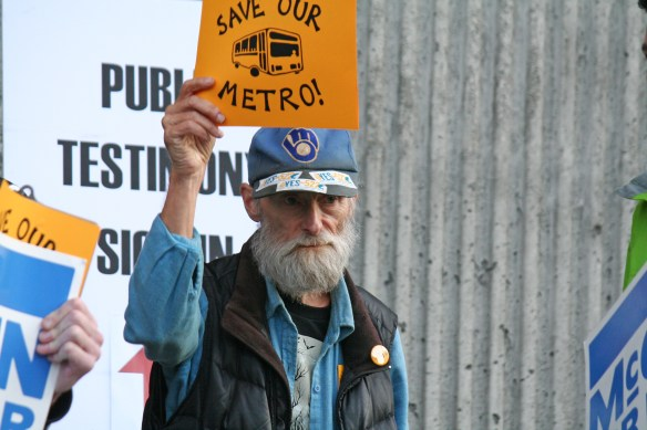 A transit supporter outside a hearing Oct. 14, 2013 in Seattle where state legislators listened to public input on transportation needs.
