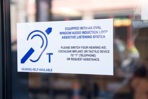Window sticker says hearing loop service available at Metro Customer Services