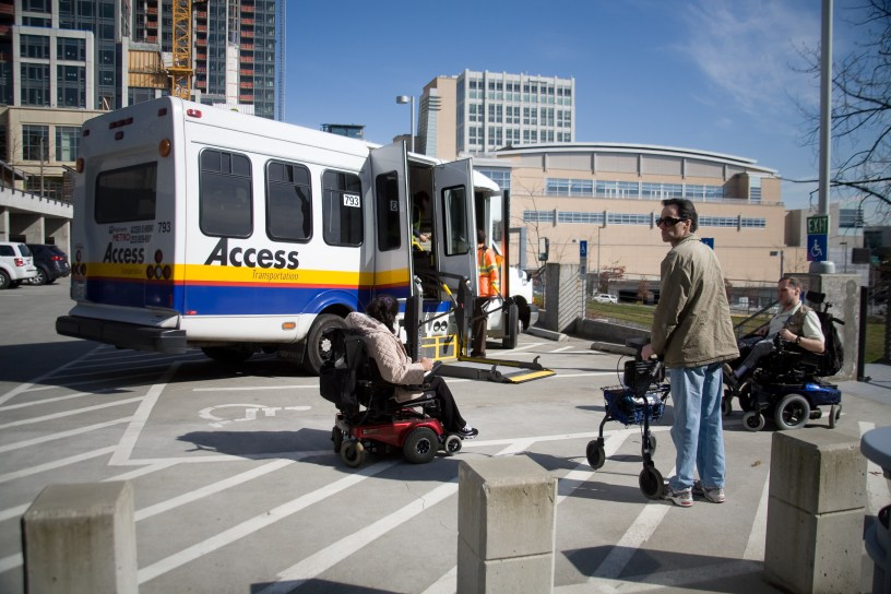 Access van waits as passengers gather to board