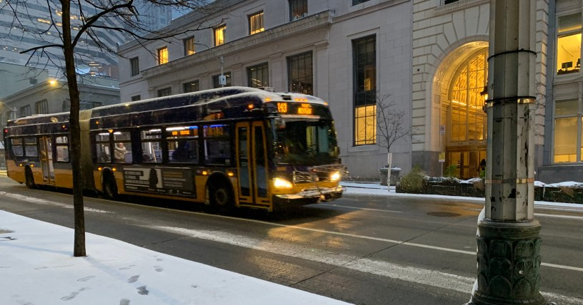 Bus traveling on city street in 2019