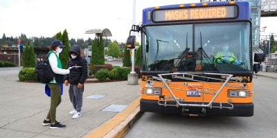 Bus reading Masks Required as Metro staff answers a rider's question