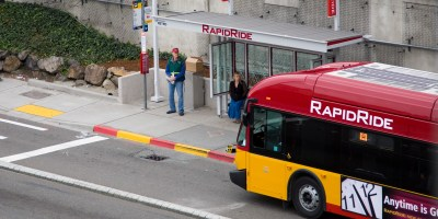 A Line bus pulls into a RapidRide stop