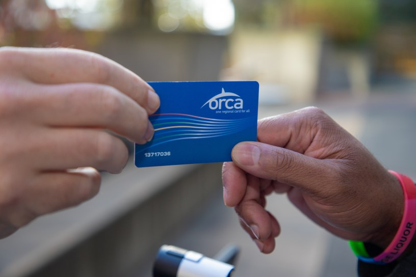 ORCA Card being handed from one hand to another