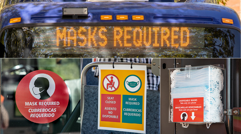 "Close up of the mask dispenser, mask decal, and ""masks required"" on electronic sign"