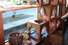Cute cat cubbies line the street facing wall.