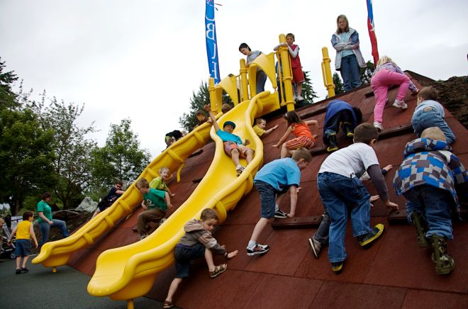 Students swarm the YSFG funded playground at Les Gove Park in 2010 in Auburn.