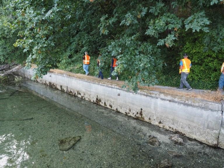 Workers walking on the bulkhead