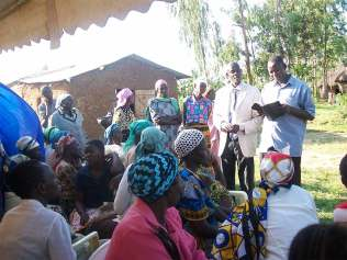 Bro.-Moses-ministering-the-word-of-encouragment-to-the-widows