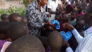 Pastor Moses and the team giving Sandals to the orphans