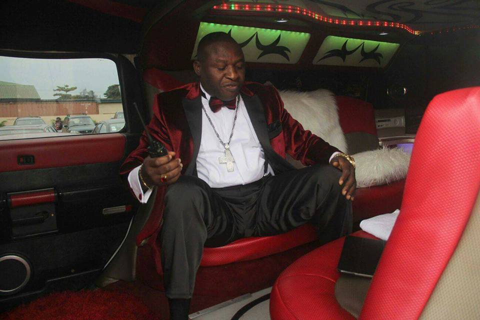 Wealthy Lagos Pastor Poses In His Hummer Limousine  Bags