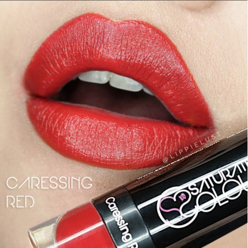 Saturated colour lipstick caressing red