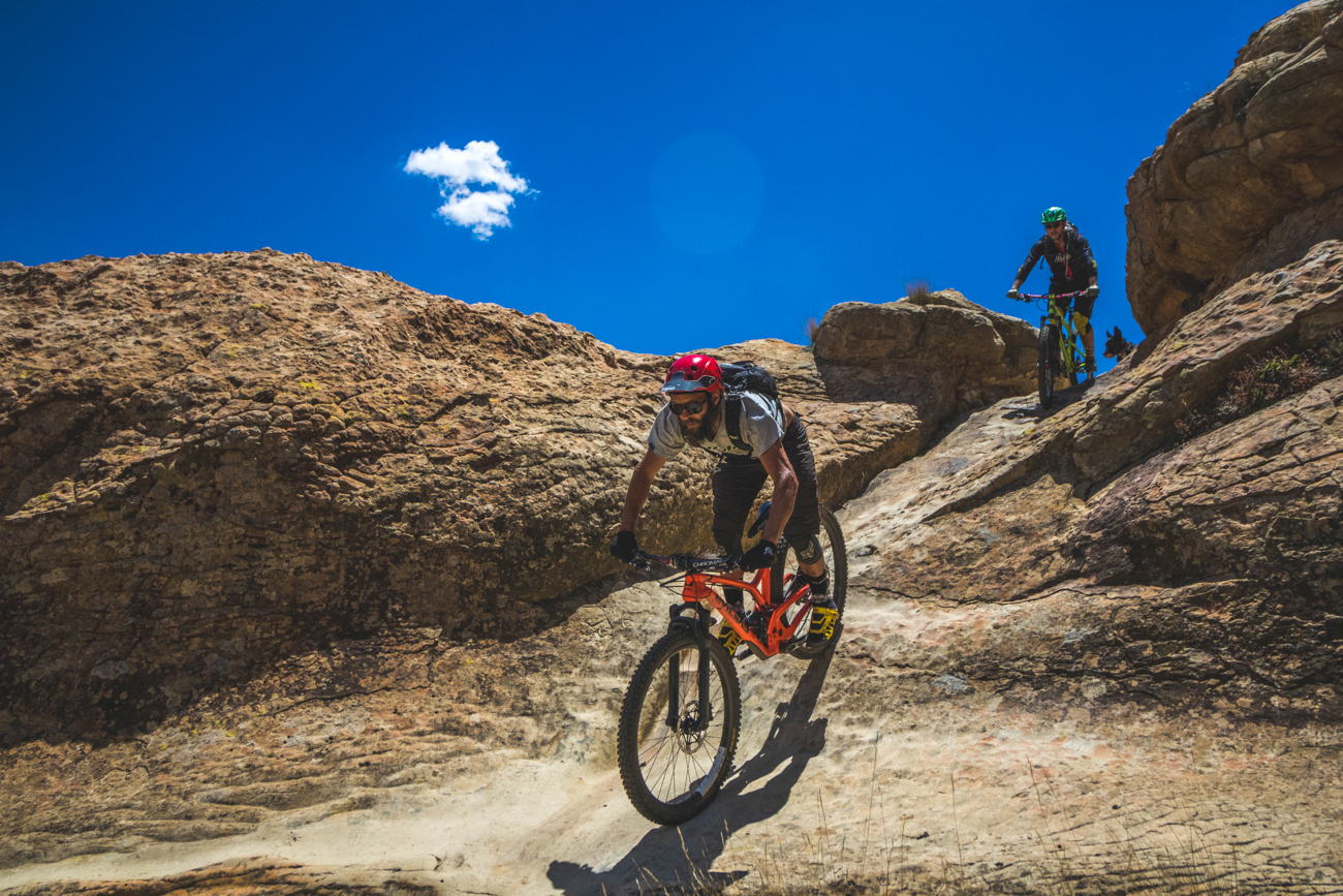 Riders christian schmidt and rene damseaux riding a sandstone enduro trail in Roma Lesotho