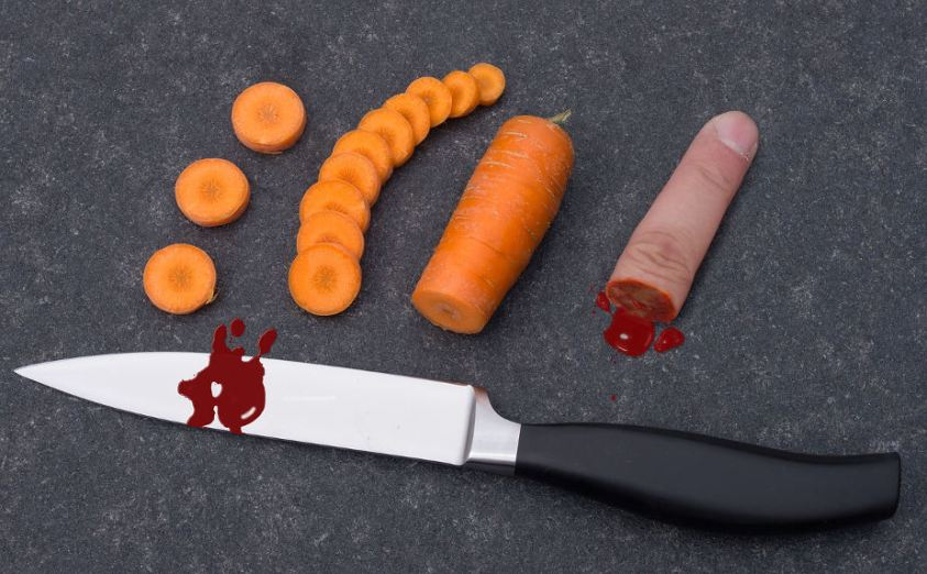 Halloween Pranks Finger and Knife on Cutting Board