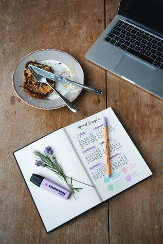 pic of a planner and laptop on a desk bucket list