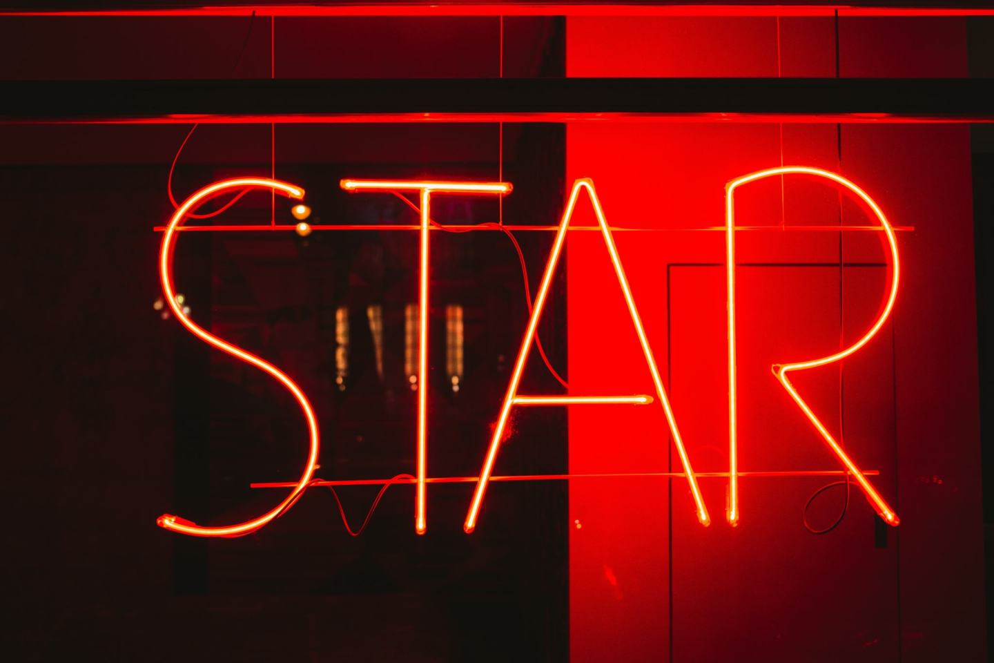Neon sign showing STAR affirmation