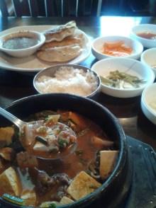 kimchi-chigae with all the sides, including kun-mandu... ah, my Korean food addiction lives on
