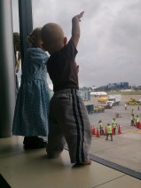 Little girl at the Airport waiting to go home