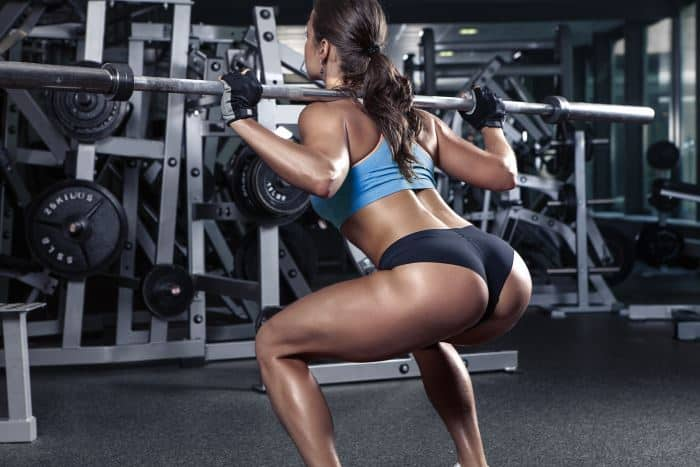 best leg exercises woman squatting