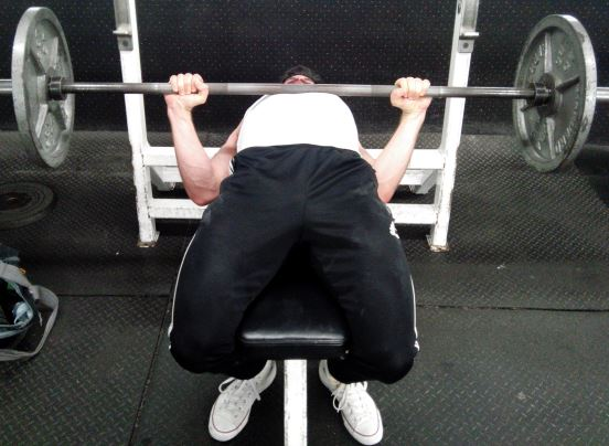 squeeze bench between thighs to increase leg drive