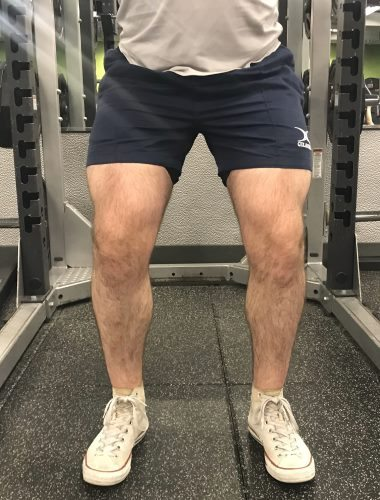 Squatting in Gilbert Rugby Shorts - Front View - Concentric Rep