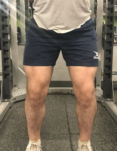 Squatting in Gilbert Rugby Shorts - Front View - Top of Squat Rep