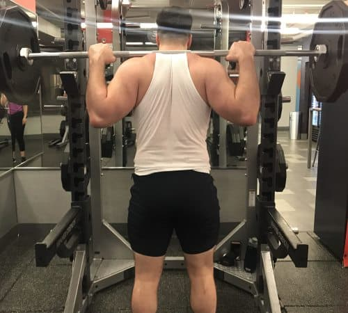Squatting in Jed North Fitted Lifting Shorts - Rear View - Top of Squat Rep