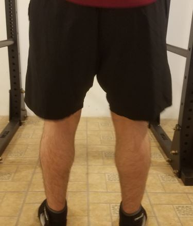 Squatting in A7 Center-stretch Shorts - Rear View - Top of Squat Rep