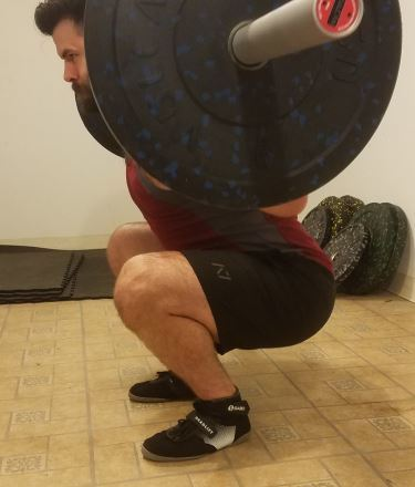 Squatting in A7 Center-stretch Shorts - Side View - Bottom of Squat Rep